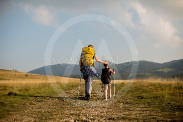 Young father and daughter enjoy hiking on a sunny day