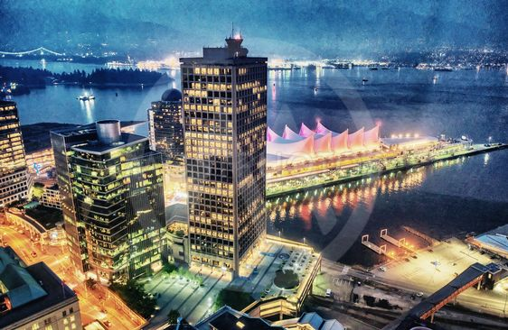 Vancouver skyline with Canada Place at night, aerial view