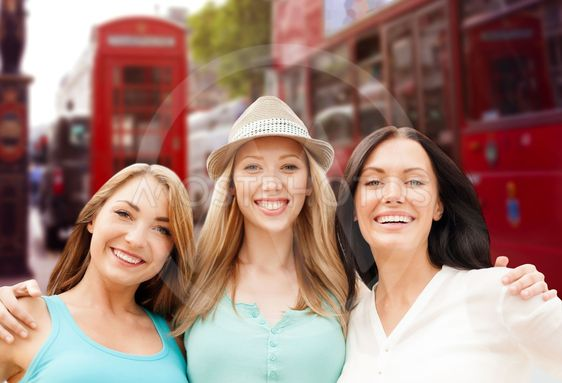 group of happy young women over london city street