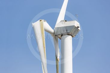 Wind turbine with broken wings after a heavy storm in the...