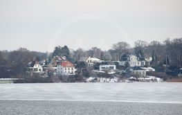 Winter Lake with Houses Water and Snow