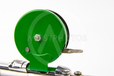 Reel for fishing equipment on a white background