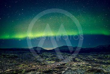 Aurora Borealis over distant mountains