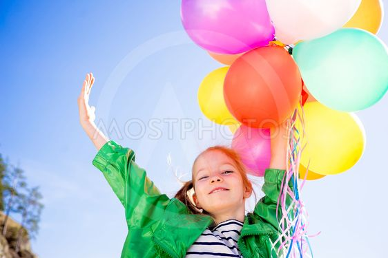 Girl is having fun with balloons