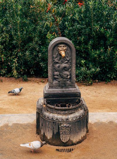 Ancient street Water Column in Barcelona, Spain. Vintage...