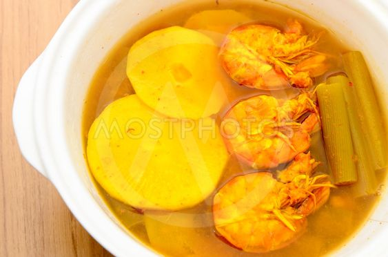 Sour and spicy shrimps curry with bamboo shoot and lotus...