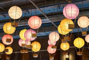 Colorful paper lanterns hang on ceiling in the mall