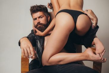 Woman nude posing with handsome muscular man. Fashion....