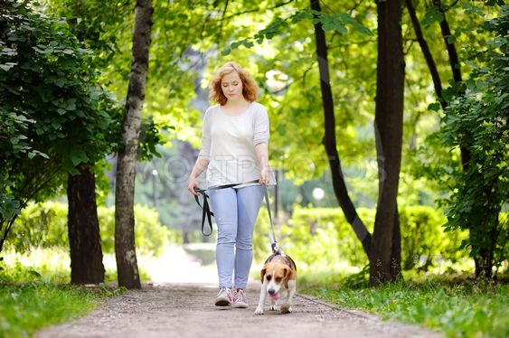 Loving female owner with her domestic pet