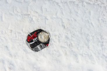 Smashed soda can on show