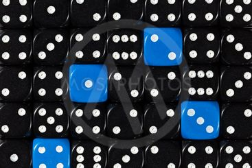 Background of random ordered black dices with four blue...