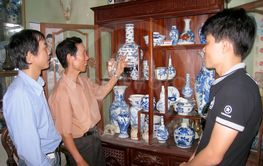 man collecting antique porcelain