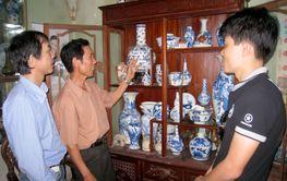 man collecting antique porcelain