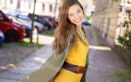 Cute stylish young woman grinning at the camera