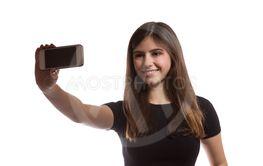 beautiful teenager girl taking a selfie