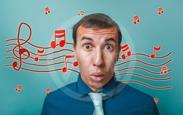 a male opened his mouth surprised businessman music notes...
