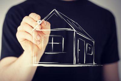 man drawing a house on virtual screen