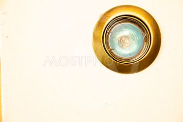 White wall with a lamp. Background. Place for text.