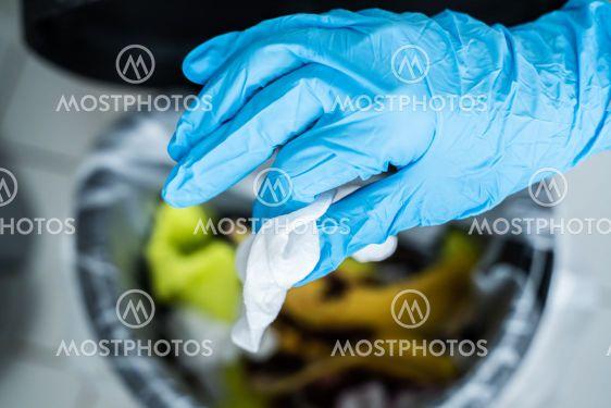 Throwing Away Dirty Sanitizing Wipe