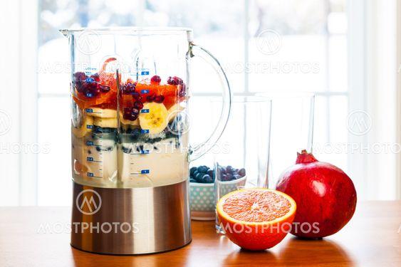 Preparing smoothies with fruit and yogurt