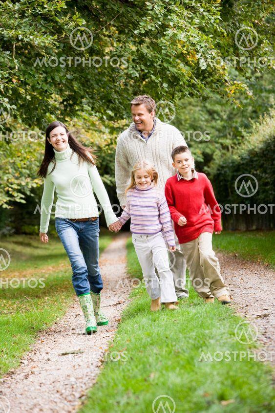 Family walking through countryside