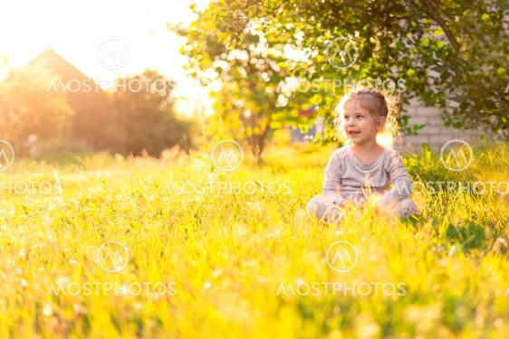 cute caucasian little girl in the country