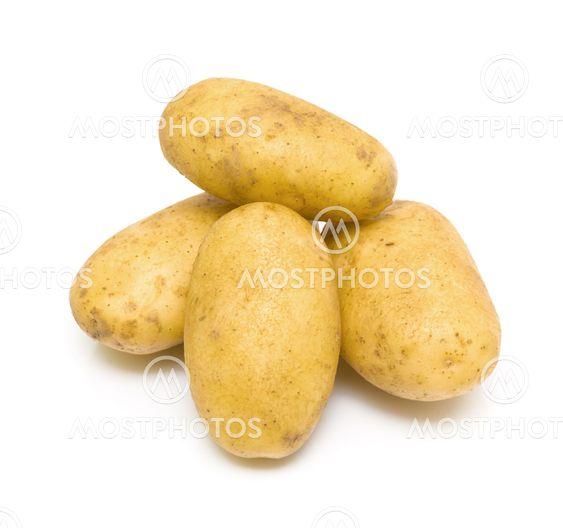Potatoes close-up on white background