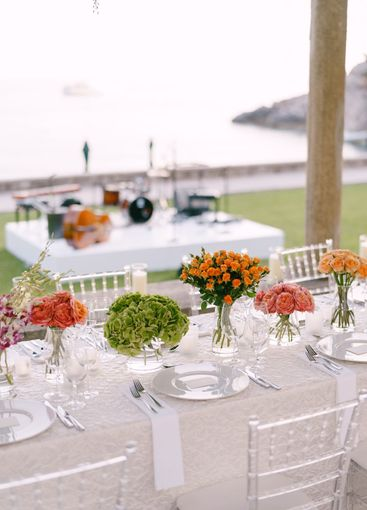 Wedding dinner table reception. A very long table for...