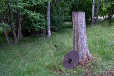 Round wooden shield penetrated by three arrows