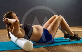 Pregnant woman doing situps