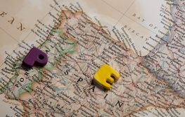photo of map of Spain and colorful letters on the...