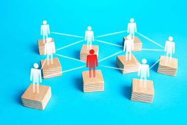 Red figurine of a person in the network of company...
