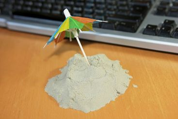 Small self-made holiday island with a colorful parasol...