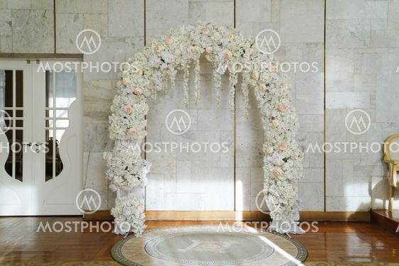 arch of artificial flowers in the registry offices....