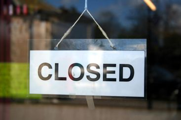 A closed sign in a shop window.