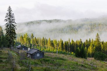 Mist over hills and buildings at Ransby, Värmland, Sweden,