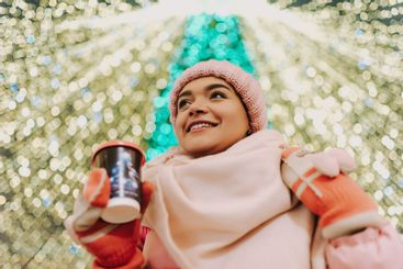 Young woman celebrating winter holidays