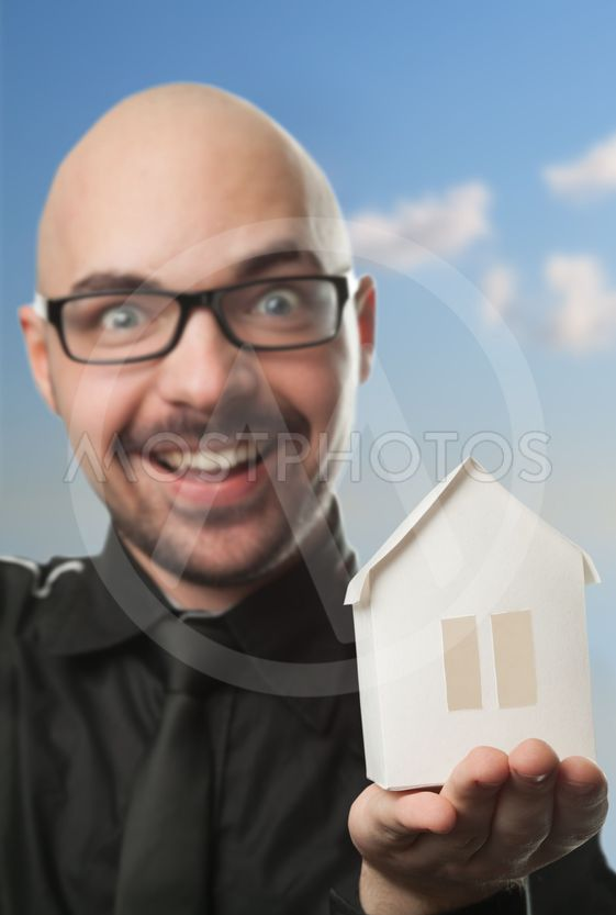 Man holding a paper house.