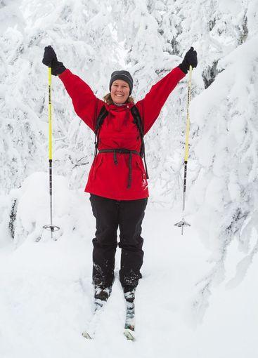 Happy female cross country skier