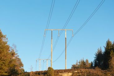 Power lines against clear sky