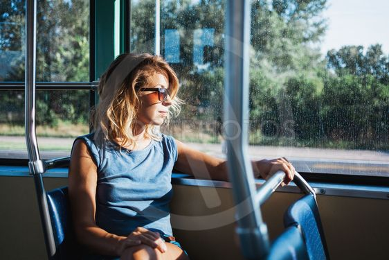 Young woman riding a public bus
