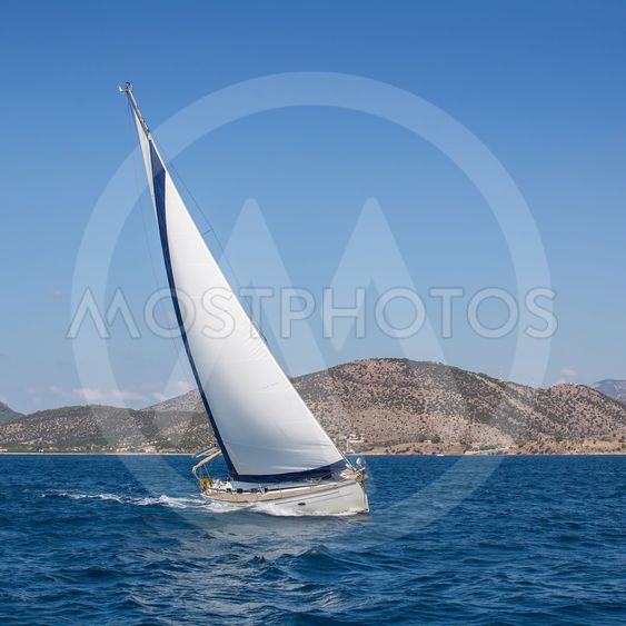 Boat competitor of sailing regatta. Yachting.