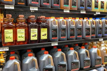 A display of bottled Iced Tea drink products aisle at a...