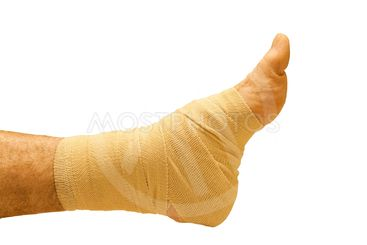 man's ankle wrapped in an elastic bandage