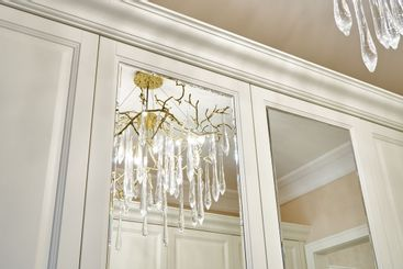 Classic white wardrobe with mirror doors in contemporary...