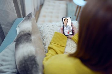 Woman from home consults her doctor in videoconference