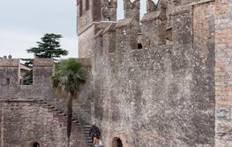 Tourists climb  to the Castello Scaligero wall in Sirmione