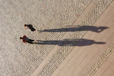 Shadow of tourists
