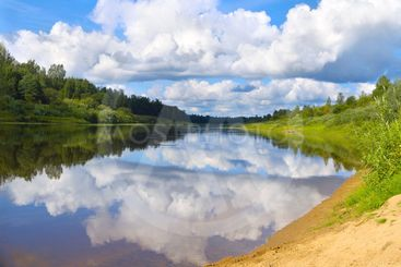 River Landscape with blue Sky and Clouds mirror...