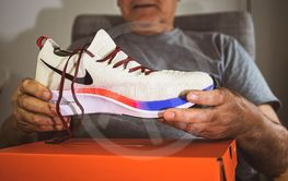 Nike Zoom Fly Flyknit senior man showing new shoes